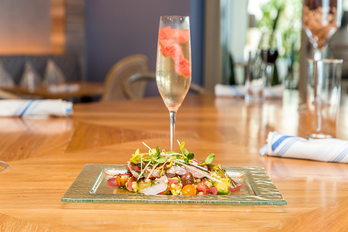salad and drink at ola oceanfront bistro