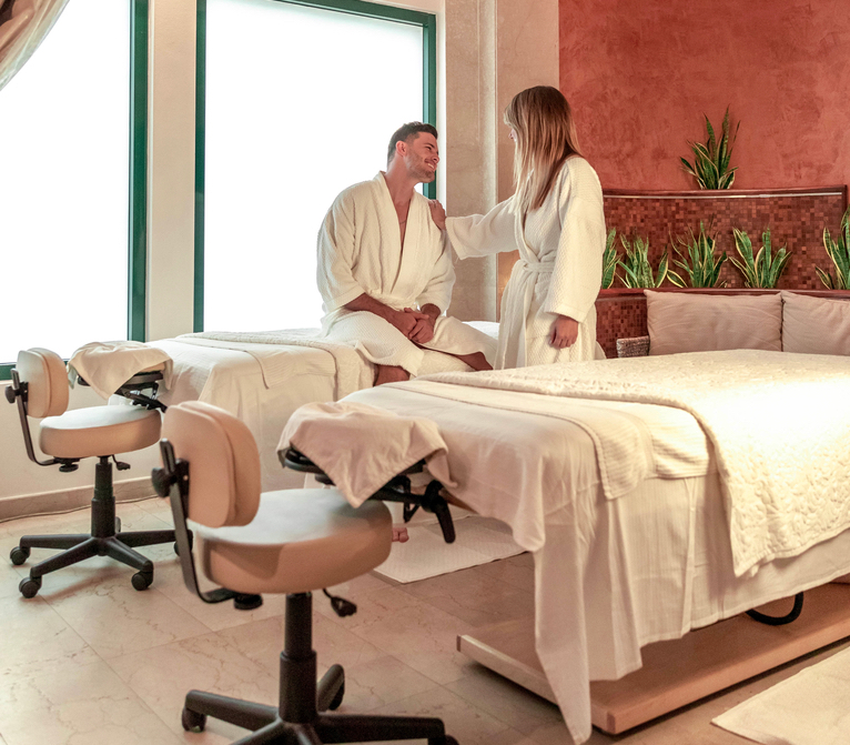 couple in spa with robes
